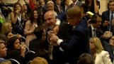 Protester dragged out of hall ahead of Trump-Putin conference