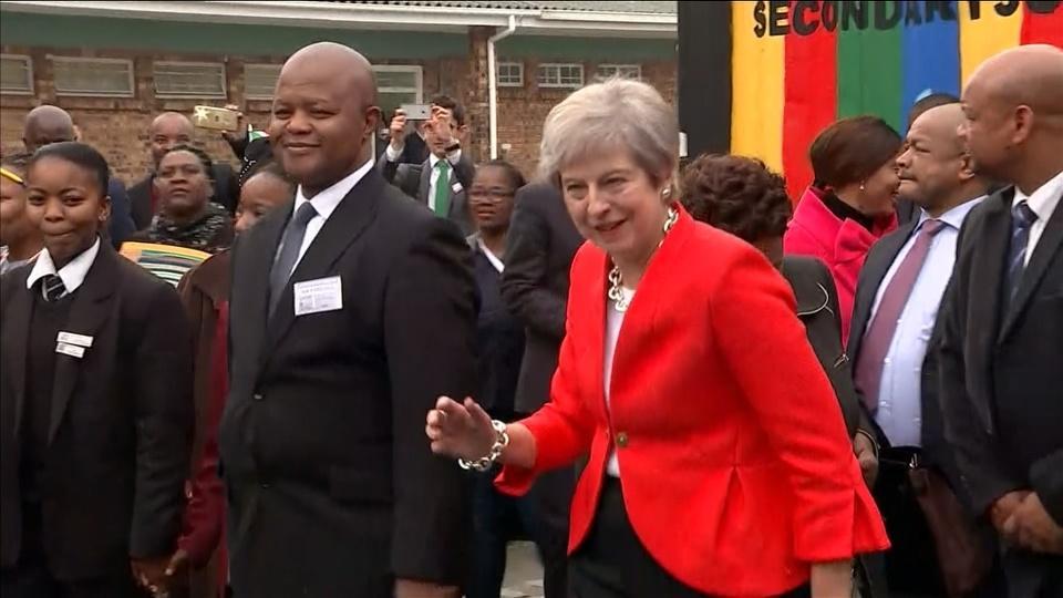 Dancing and smiling, Britain's May seeks to bolster ties in Africa visit