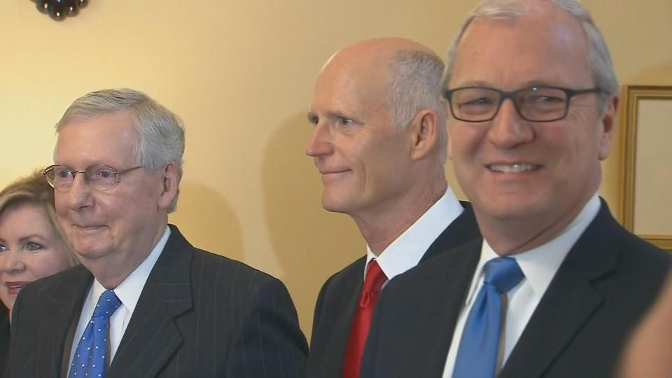 Rick Scott shows up for DC photo op, mum on fraud