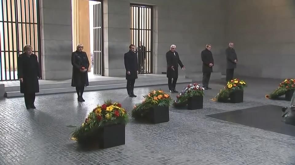 Macron and Merkel pay respects at Berlin war memorial