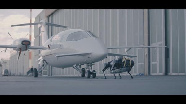 Four-legged robot pulls plane