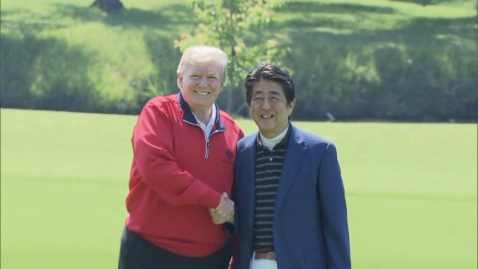 U.S. President Donald Trump plays golf with Japanese PM Abe