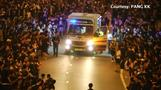 Hong Kong protesters make way for ambulance to pass through during mass rally