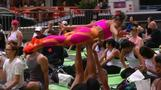 Rain can't stop yogis from celebrating the summer solstice in Times Square