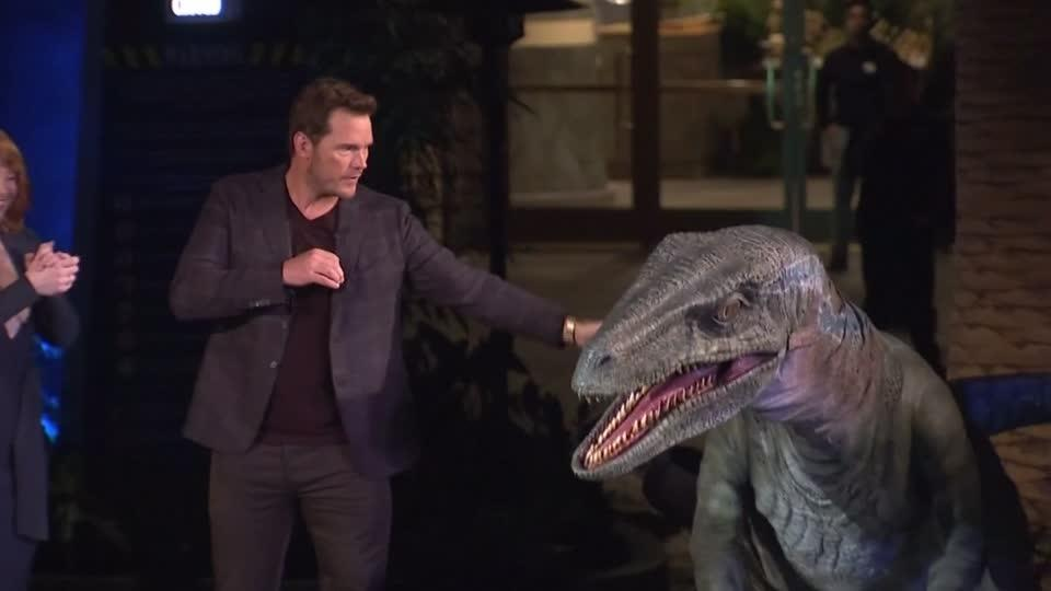 Chris Pratt eye-to-eye with raptor at new Jurassic World water ride
