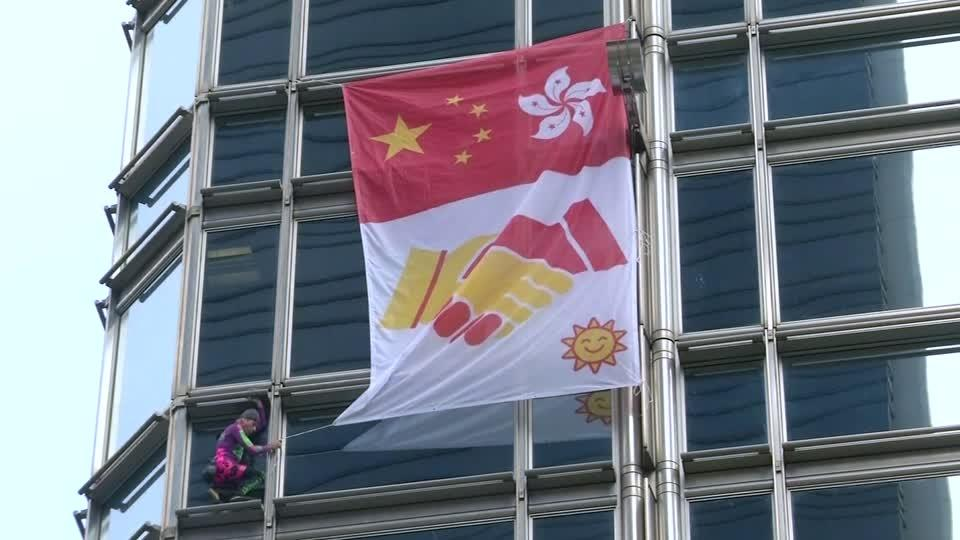 French 'Spiderman' hangs peace banner in Hong Kong