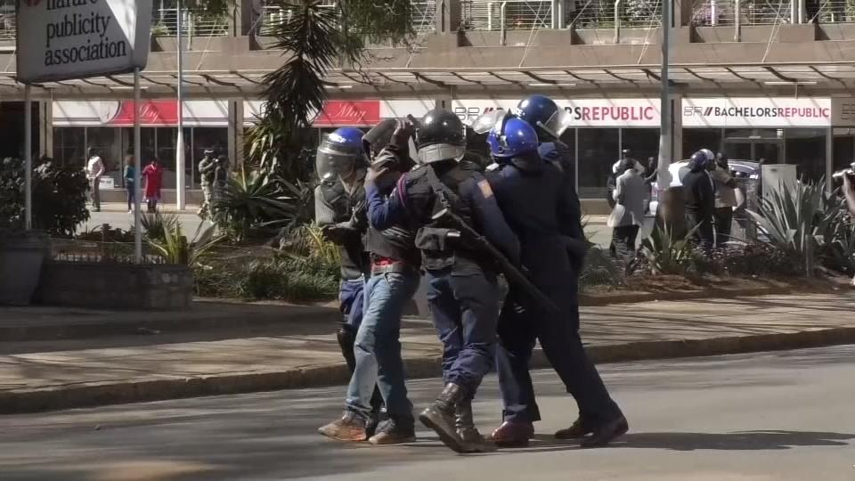 Tensions flare as Zimbabwe police beat protesters