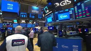 Wall Street sinks on trade tensions