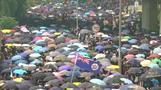 الآلاف يشاركون في مسيرة في هونج كونج وإغلاق أربع محطات لقطارات الأنفاق