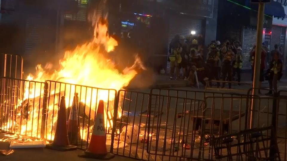 Hong Kong police fend off airport protest but tear gas fired again in Kowloon.