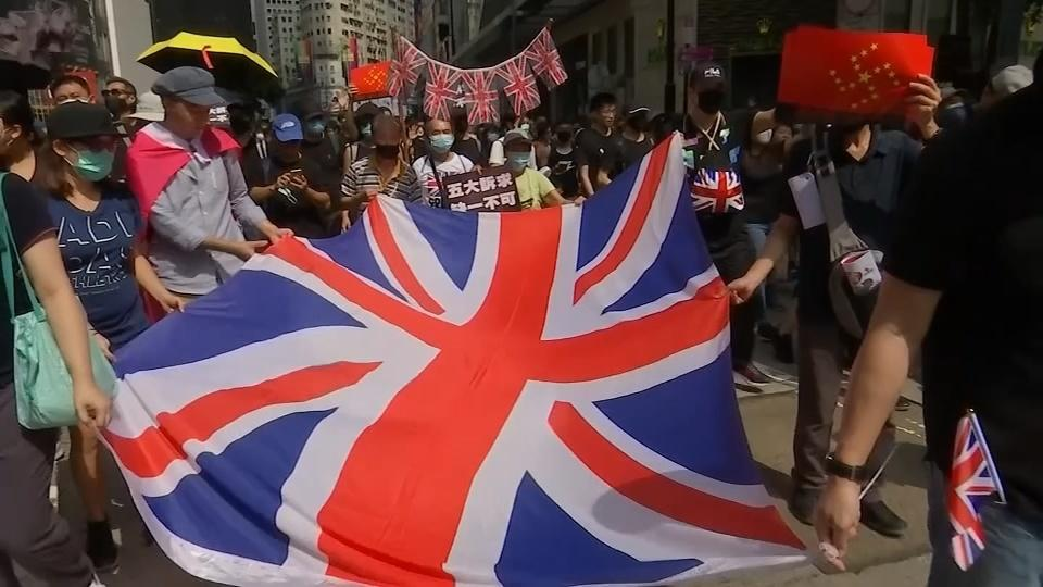 Hong Kong protesters march and sing in plea to Britain