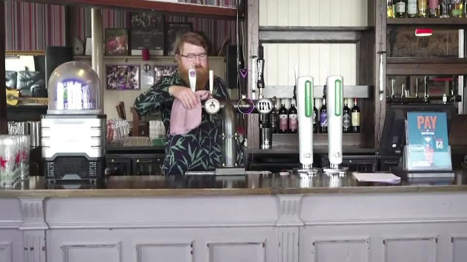 Cheers! And fears too, as English pubs reopen