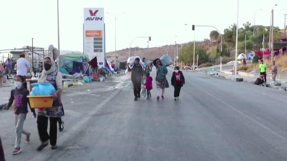 Lesbos migrants pour into temporary camp