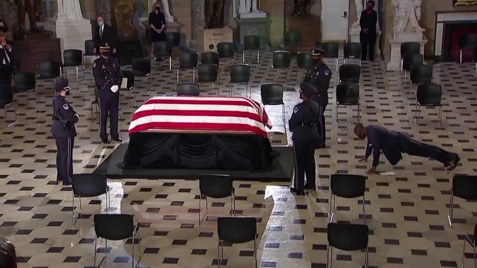 Ginsburg's trainer does push-ups in front of casket