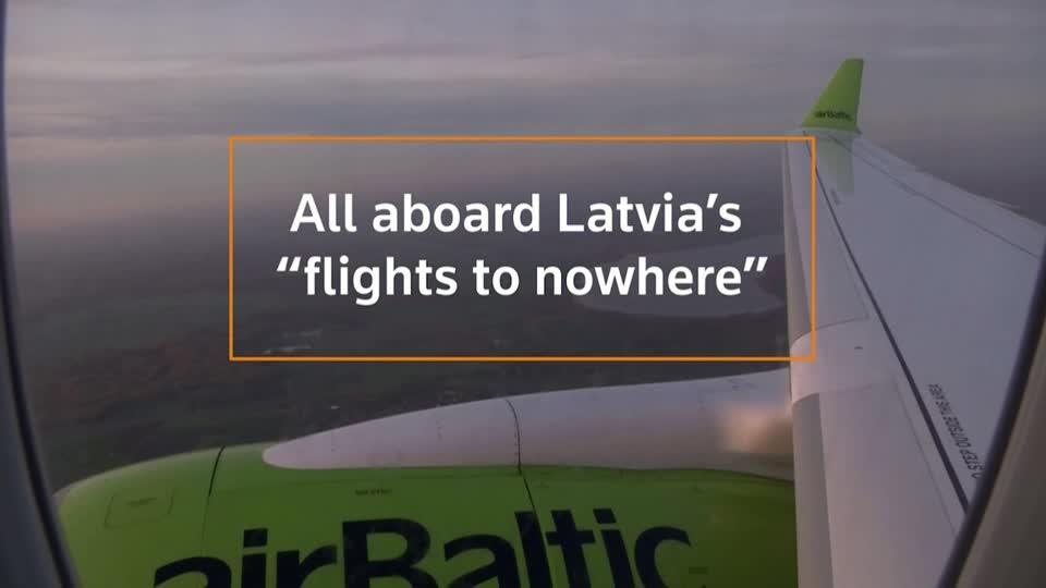 Latvians board 'flight to nowhere'