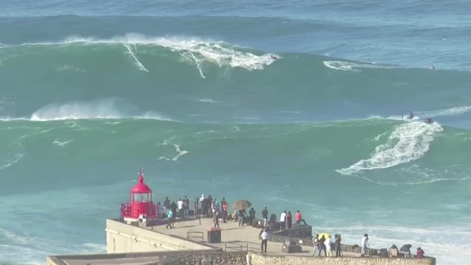 Surfers tackle Portugal's monstrous waves