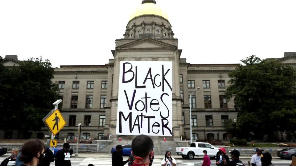 Rights groups urge companies to fight Georgia voting curbs
