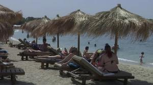 Hoping to lure tourists, Greece reopens beaches