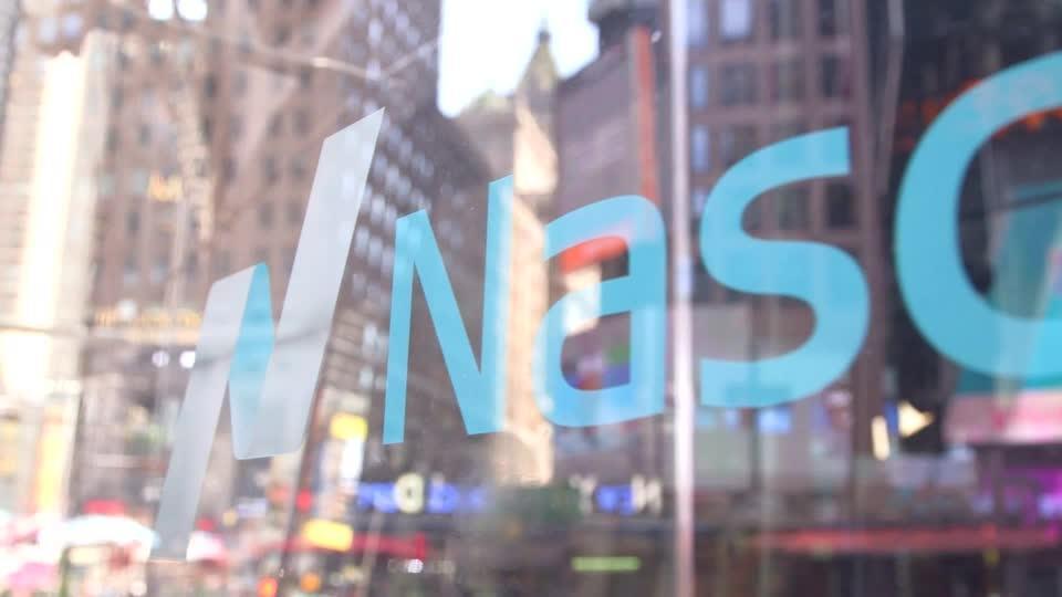 Tech stocks drive Nasdaq to higher close
