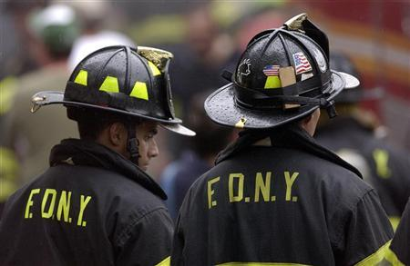 Two firefighters in New York, August 27, 2006. New York firefighters have  been forced to strip their lockers American flags, stickers expressing  support for ...