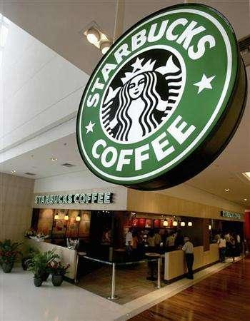 Customers visit Starbucks' first store in Brazil, the world's second biggest market for coffee after the United States, in Sao Paulo in this November 30, 2006, file photo. Starbucks Chairman Howard Schultz told executives in a memo last week that measures taken to fuel the coffee shop chain's rapid expansion had led to a ''watering down'' of its iconic brand.