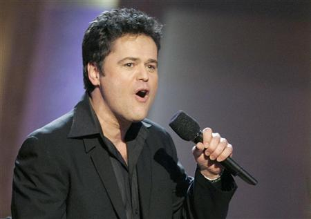 Donny Osmond performs during a taping of the TV Land awards show in Santa Monica, California in this file photo from March 19, 2006. A new ''reality'' TV show hosted by onetime teen idol,Osmond, ''The Great American Dream Vote,'' has been dumped from ABC's schedule after just two episodes that got clobbered in the ratings. REUTERS/Fred Prouser