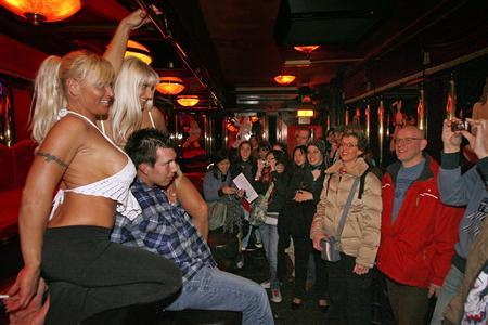 Visitors flood amsterdams red light district banana bar dancers sunny l and love pose with a visitor during the open day of amsterdams red light district march 31 2007 reuterstoussaint kluiters aloadofball Image collections