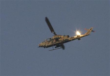 An Israeli Cobra helicopter is shown firing a flare while flying over the Gaza Strip in this November 1, 2006 file photo. Israeli helicopters fired into the Gaza Strip on Saturday, killing one Palestinian militant, in what local residents said was the fiercest exchange between Israeli forces and militants since a November truce. REUTERS/Gil Cohen Magen