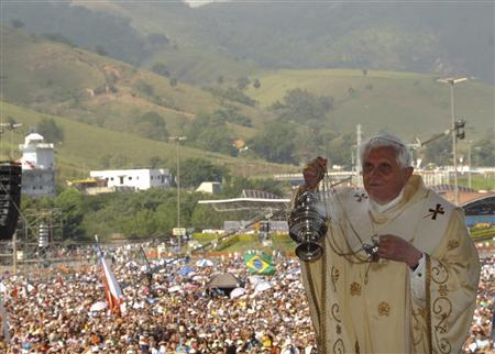 Pope Benedict XVI wafts incense during an open air mass in front of the Basilica of Our Lady of Aparecida, Brazil's national saint, in the city of Aparecida, 103 miles (166 km) outside of Sao Paulo, May 13, 2007. REUTERS/Osseratore Romano