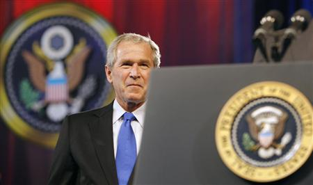 President George W. Bush looks up as he is introduced to speak at the President's Dinner at the Washington Convention Center June 13, 2007. REUTERS/Kevin Lamarque