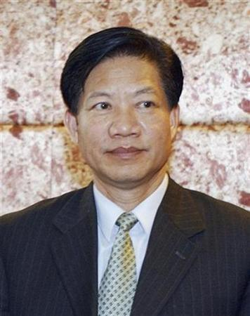Zheng Xiaoyu, former director of China's State Food and Drug Administration (SFDA), is seen during a meeting in Beijing in this October 28, 2004 file photo. Zheng was executed on Tuesday after being found guilty of corruption and dereliction of duty amid a series of food and drug safety scandals, Xinhua news agency said. REUTERS/China Daily/Files