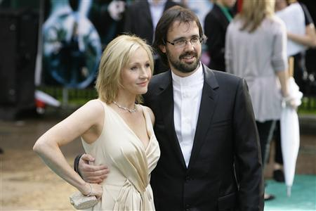 Author J.K. Rowling [L] and her husband Neil Murray arrive at the British premiere of the new film ''Harry Potter and the Order of the Phoenix'' in London July 3, 2007. Nearly a fifth of Harry Potter fans say they will skip straight to the last page of the final book to find out how what happens to the boy wizard, a survey showed on Saturday. REUTERS/James Boardman