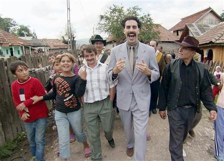 Sacha Baron Cohen (C) is shown in a scene from the film 'Borat: Cultural Learnings of America for Make Benefit Glorious Nation of Kazakhstan' in this undated publicity photograph. State restrictions on use of the Internet have spread to more than 20 countries that use catch-all and contradictory rules to help keep people off line and stifle feared political opposition, a new report says. The report cited a prominent incident in 2005 when Kazakhstan seized all .kz Internet domains and closed one deemed offensive and run by Cohen. REUTERS/Fox Searchlight Pictures/Handout