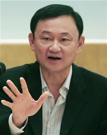 Thailand's former Prime Minister Thaksin Shinawatra gestures during a news conference in Hong Kong July 7, 2007. Shinawatra is unfit to own an English football club because of ''serious human rights abuses'' under his leadership, Human Rights Watch said. REUTERS/Bobby Yip