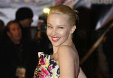 <p>Kylie Minogue poses as she arrives at the Cannes Festival Palace to attend the NRJ Music Awards, January 26, 2008. REUTERS/Gilbert Tourte</p>