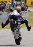 <p>Il pilota di MotoGP Jorge Lorenzo dopo aver ottenuto la pole position sul circuito di Jerez, in Spagna. REUTERS/Anton Meres</p>