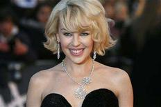 <p>Singer Kylie Minogue arrives for the Brit Awards at Earls Court in London February 20, 2008. REUTERS/Luke MacGregor</p>