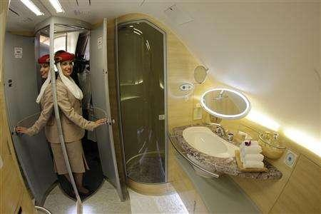 A Stewardess Poses Inside Bathroom Of The A380 Aircraft During Hand Over Ceremony