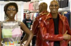<p>Russian designer Denis Simachev poses for a picture in his boutique in Moscow September 19, 2008. As Russia is hit hard by the financial crisis, now it the time to spend lavishly, says Moscovite fashion designer Denis Simachev. Picture taken September 19, 2008. REUTERS/Thomas Peter</p>