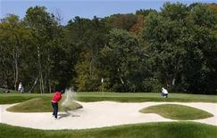 <p>Anthony Kim of the U.S. Ryder Cup team hits from the sand on the second hole as Spain's Sergio Garcia (R) of the European Ryder Cup team watches during singles play in the 37th Ryder Cup Championship at the Valhalla Golf Club in Louisville, Kentucky September 21, 2008. REUTERS/Eddie Keogh</p>