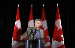 <p>Conservative leader and Canada's Prime Minister Stephen Harper listens to a question during a news conference in Calgary, Alberta September 26, 2008. Canadians will head to the polls in a federal election October 14. REUTERS/Chris Wattie</p>