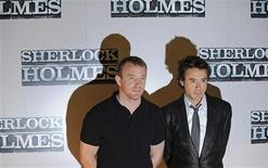 """<p>British director Guy Ritchie (L) and U.S. actor Robert Downey Jr. attend a photocall for his film """"Sherlock Holmes"""" in central London October 1, 2008. REUTERS/Toby Melville</p>"""