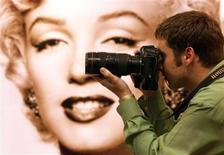 <p>A press photographer takes pictures at an exhibition of Marilyn Monroe property at Christie's auction house in London in this file photo.  REUTERS/Paul Hackett</p>
