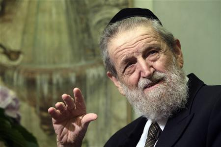 Rabbi Shear-Yashuv Cohen, Chief Rabbi of Haifa, is interviewed by a television crew at his hotel in Rome October 6, 2008. REUTERS/Alessandro Bianchi