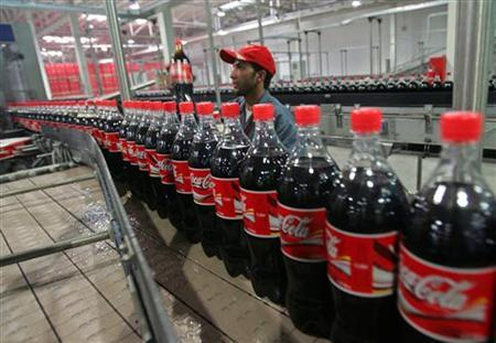 A worker checks bottles of Coca-Cola at the newly inaugurated bottling plant in Kabul, September 10, 2006. REUTERS/Ahmad Masood