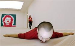 <p>A silica gel sculpture called Communication by Cang Xn is displayed as part of the exhibition 'The Revolution Continues : New Art from China' in the new Saatchi Gallery, in London October 6, 2008. REUTERS/Luke MacGregor</p>