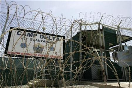 The front gate of Camp Delta is shown at the Guantanamo Bay Naval Station in Guantanamo Bay, Cuba September 4, 2007. REUTERS/Joe Skipper
