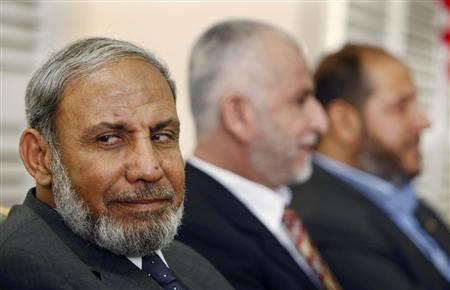 Senior Hamas leaders Mahmoud al-Zahar (L), Saeed Seyam (C) and Khalil al-Hayya wait at the Rafah border crossing in the southern Gaza Strip before crossing into Egypt October 7, 2008. REUTERS/Ibraheem Abu Mustafa