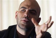 <p>Italian anti-mafia writer Roberto Saviano speaks to a reporter in Rome in this file photo taken April 7, 2008. REUTERS/Alessandro Bianchi/Files</p>