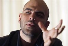 """<p>Italian anti-mafia writer Roberto Saviano,29, speaks to a reporter in Rome in this file photo taken April 7, 2008. Police in Italy are looking into reports that the Naples mafia plans to carry out its threat to kill the author of the best-selling book """"Gomorra"""", which has been made into a hit movie about mafia brutality, by Christmas. REUTERS/Alessandro Bianchi/Files</p>"""